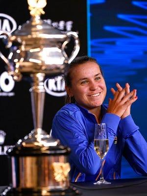 Sofia Kenin of the U.S. answers questions at a press conference following her win over Spain's Garbine Muguruza in the women's final at the Australian Open tennis championship in Melbourne, Australia, Saturday, Feb. 1, 2020.
