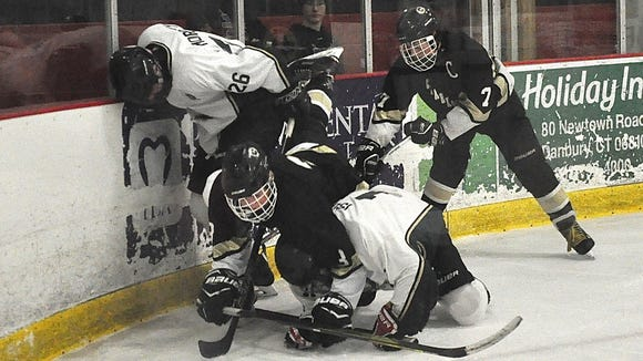 Clarkstown's Kevin Smith (l) on knees and BrewTown's Mike Isola (r) on knees battle for puck with Yorktown's Kevin Moroney (26) and Clarkstown's Riku Robins..