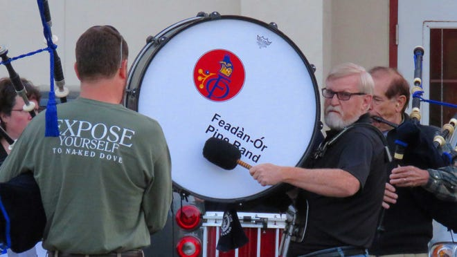 Scott Van Groll plays bass drum with his pipe band