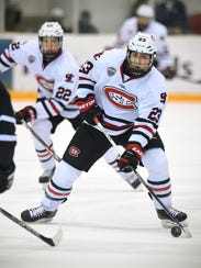 St. Cloud State's Robby Jackson brings the puck into