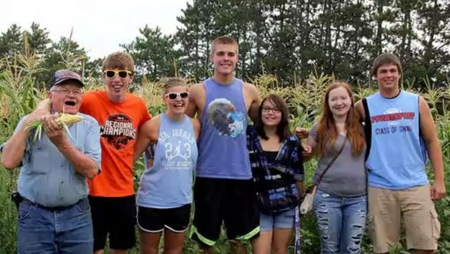 Farmer Harold Altenburg, pictured here with students in the Corn Class of 2016, has seen the positive impact the farm experience has on young people. His vision for Altenburg's Farm is to benefit the community as a not-for-profit farm school.