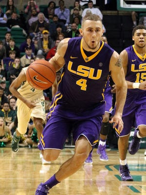 LSU guard Keith Hornsby (4) brings the ball down the court against UAB on Dec. 18.