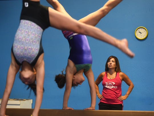 Suzi Otuafi, owner of Flips Gymnastics, works with