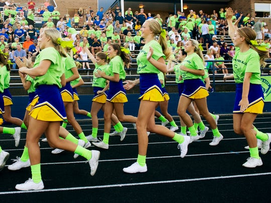 The Castle cheerleaders don Play for Kate t-shirts while cheering on their Knights football team Friday night.