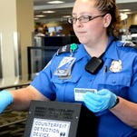 Sara Fujii, a Transportation Security Administration officer, scans a TSA PreCheck traveler's flight ticket at the Reno-Tahoe International Airport last week.