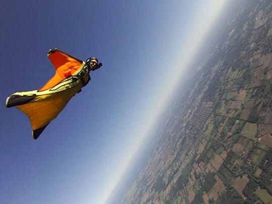 Kristal Ciamillo uses a wingsuit to fly over Ray, Mich.