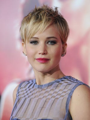 """Actress Jennifer Lawrence arrives at the Los Angeles premiere """"The Hunger Games: Catching Fire"""" at Nokia Theatre on Nov. 18."""