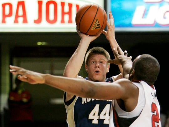 Notre Dame's Luke Harangody shoots over Louisville's Samardo Samuels during the first half of their NCAA college basketball game in Louisville, Ky., Jan. 12, 2009.