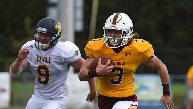 Salisbury's Ryan Kolb carries for a gain against the College of New Jersey's Thomas Koenig.