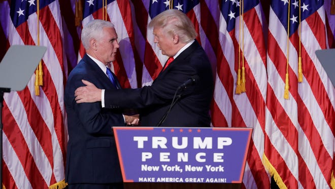 President-elect Donald Trump shakes hands with Vice President-elect Mike Pence during his election night rally on Nov. 9, 2016, in New York.
