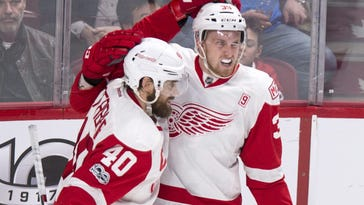 Red Wings' Anthony Mantha, right, celebrates with teammate Henrik Zetterberg after scoring the winning goal past Canadiens goalie Al Montoya during overtime Tuesday. Detroit won 2-1.