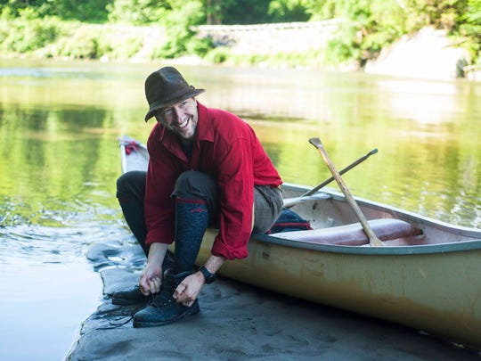 Michael DeBonis, the executive director of the Green Mountain Club, is hiking the length of the Long Trail using only the equipment available to the trail's founders when it was established in 1917.  DeBonis donned his leather boots pack after canoeing across the Winooski River in Bolton on Wednesday, June 22, 2017, eschewing the footbridge built a few years ago.