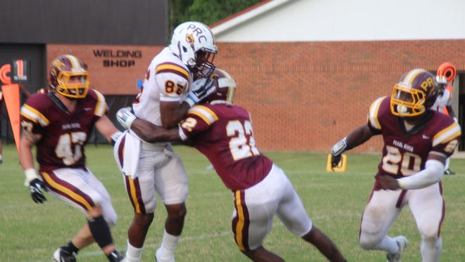 Wide receiver Joronnnie Hinton catches a pass in the Wildcats' spring scrimmage at PRCC.