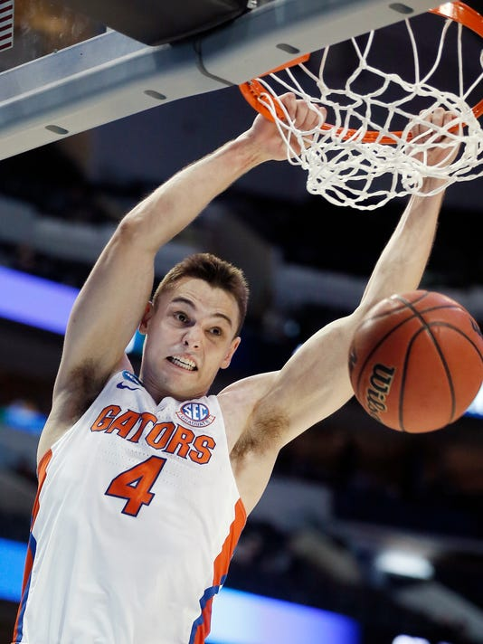 Florida guard Egor Koulechov dunks during the second half of a first-round game against St. Bonaventure at the NCAA college basketball tournament in Dallas, Thursday, March 15, 2018. Florida won 77-62. (AP Photo/Brandon Wade)