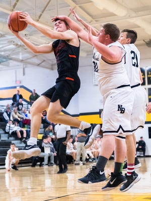 Rosman's Hooper Thomas is fouled on by North Buncombe's Caleb Gillespie during their game in Tuscola's Holiday Classic tournament Thursday, December 28, 2017.