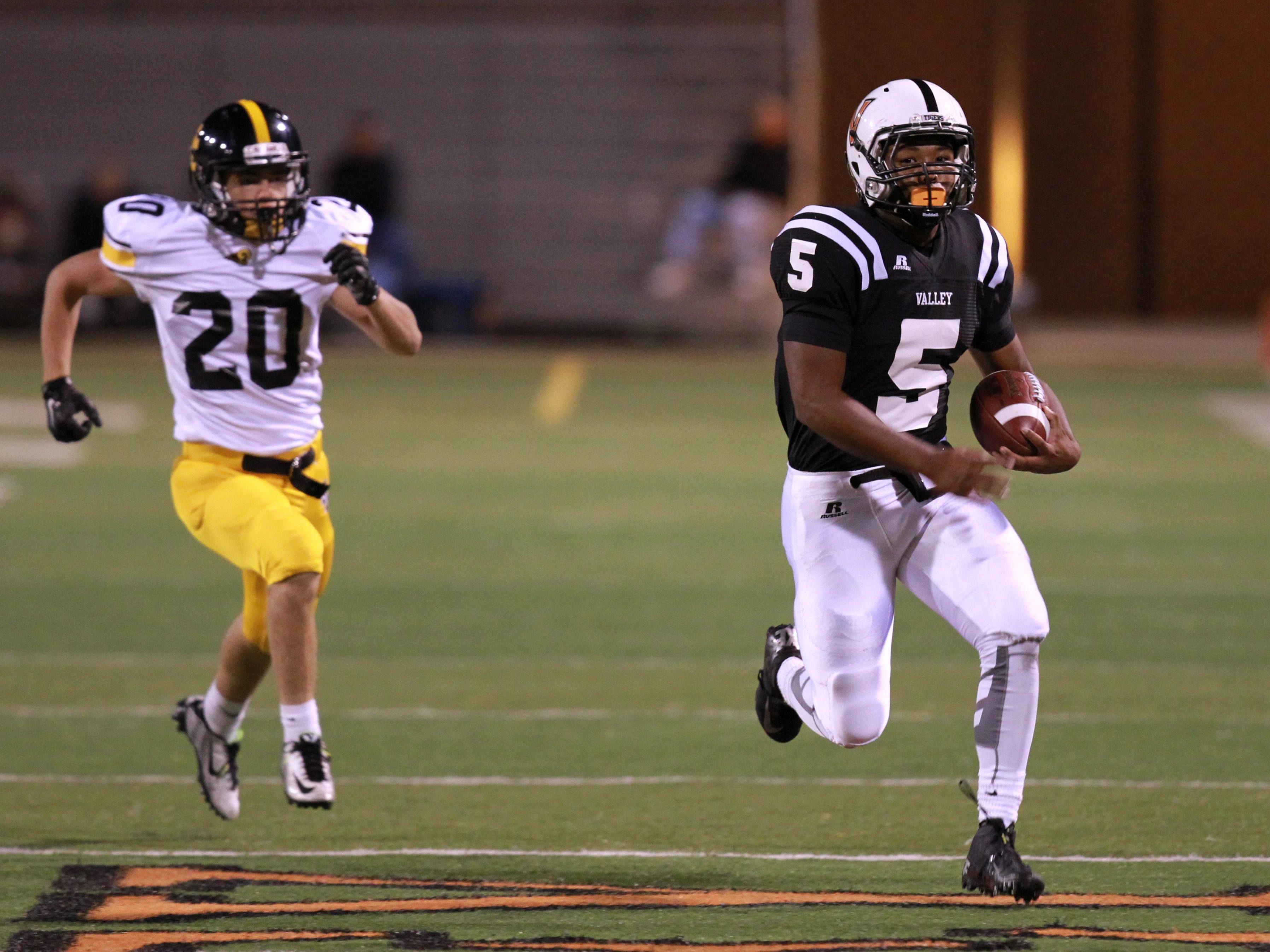September 11, 2015; West Des Moines, IA, USA; West Des Moines Valley Tigers Javon Mason runs away from Jonah Quick of the SE Polk Rams for a touchdown. Reese Strickland- For the Des Moines Register