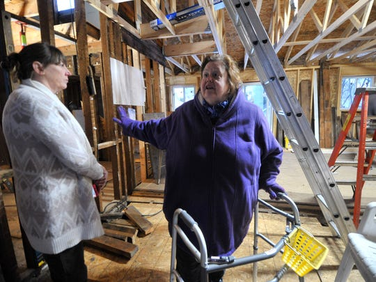 Cathy Smith, right, and her brother's girlfriend Vicki Haynes, both of Wausau, take a tour of her future home in Wausau.