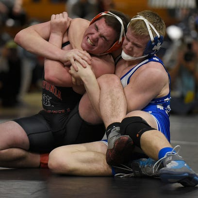 Catholic Central's Dane Flynn (right) grapples Churchill's