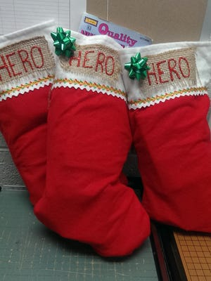"Stockings with the word ""hero"" written on them are lined up. They were a few of the roughly 2,000 holiday stockings sent to cheer up soldiers overseas in 2016."