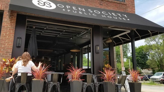 A garage door out front swings wide open at Open Society, a breakfast, lunch and dinner tribute to South America.