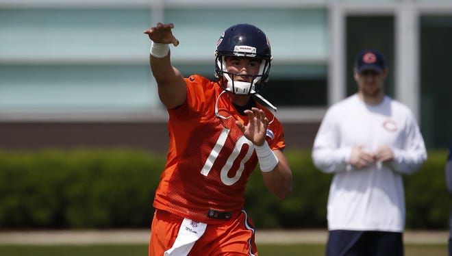 Chicago Bears quarterback Mitchell Trubisky works out with teammates during NFL football rookie minicamp in Lake Forest, Ill., Friday, May 12, 2017.