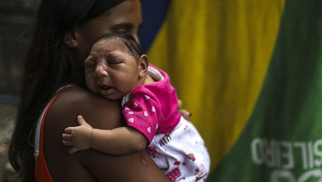 Leticia de Araujo holds her 1-month-old daughter Manuelly Araujo da Cruz in Rio de Janeiro. The CDC recently gave Mississippi $400,000 to fight the Zika virus.To date, 14 cases have been reported in the state.
