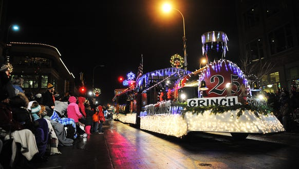 Floats make their way up Phillips Avenue during the