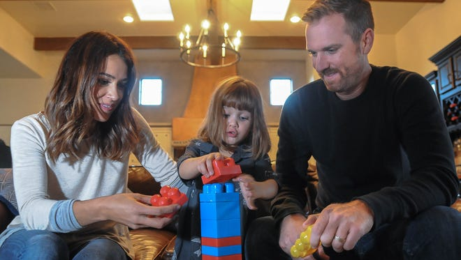 Willow Tierney, 3, plays with her parents Ashley and Nate at their home near Mesilla. Willow is the Tierney's third child, who was born vaginally after Ashley Tierney's first two children were born via C-sections.