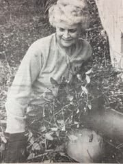 June Wolfe and other members of the Henshaw Homemakers worked hard to clear weeds from around their clubhouse in May 1989.
