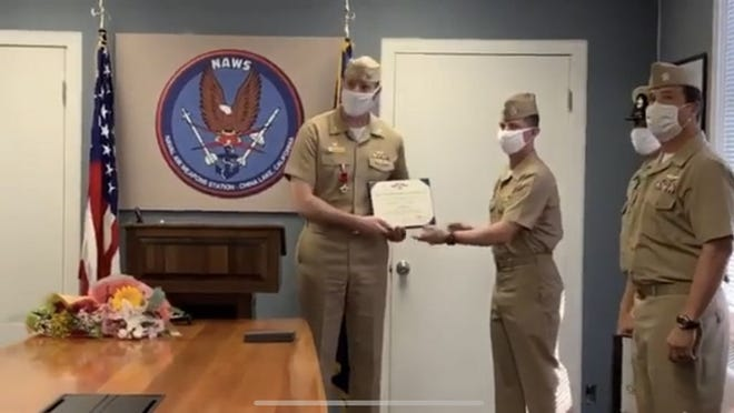 Capt. Paul Dale, left, transfers command of Naval Air Weapons Station China Lake to Capt. Jeremy Vaughn during a virtual ceremony Wednesday.