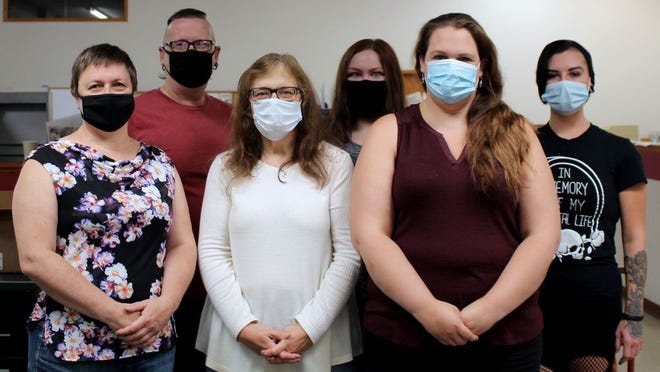 Even the staff of the Montevideo American-News wear masks! They normally practice social distancing, but made an exception for the sake of this stunning photo. Pictured in front, from left, are: Helene Kelley, Janell Sjurseth, and Samantha Godfrey. In back are Mike Milbrandt, Lynsee Lauritsen and Danae Milbrandt.