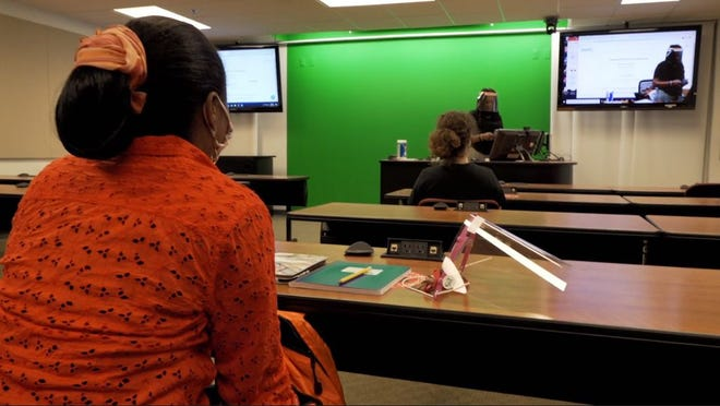 Dr. Francisca Oboh-Ikuenobe, professor of geology and biological sciences, teaches students using a green screen on the first day of Missouri S&T classes.