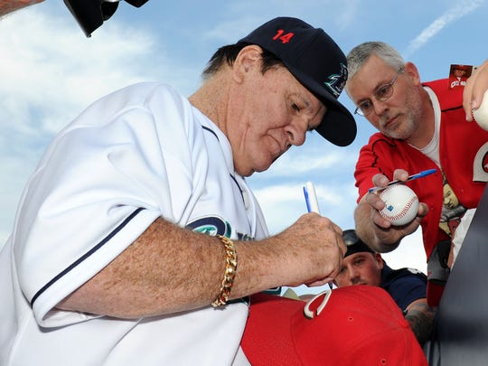 Former Major League Baseball player Pete Rose signs an autograph in 2014 in Bridgeport, Connecticut.