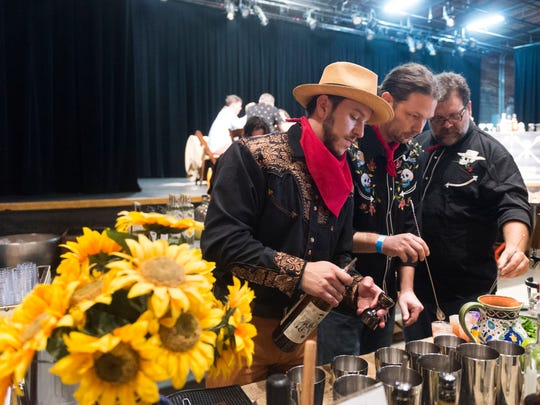 Palmer Mason of Craft Accommodations, left, with Daniel Delph and Mike Frede of Last Days of Autumn brewery take part in the 2017 Knox Brewtails contest.
