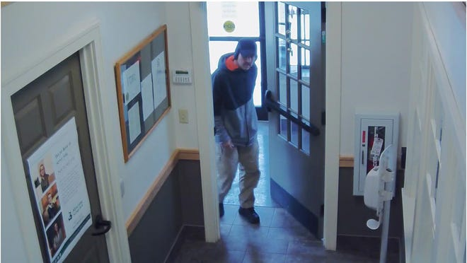Cameras show a robbery suspect entering the Mascoma Savings Bank in Hartland.