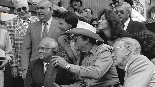 """Clayton Moore receives his """"Star"""" on the Walk of Fame in 1987. Dawn is behind him in the picture."""