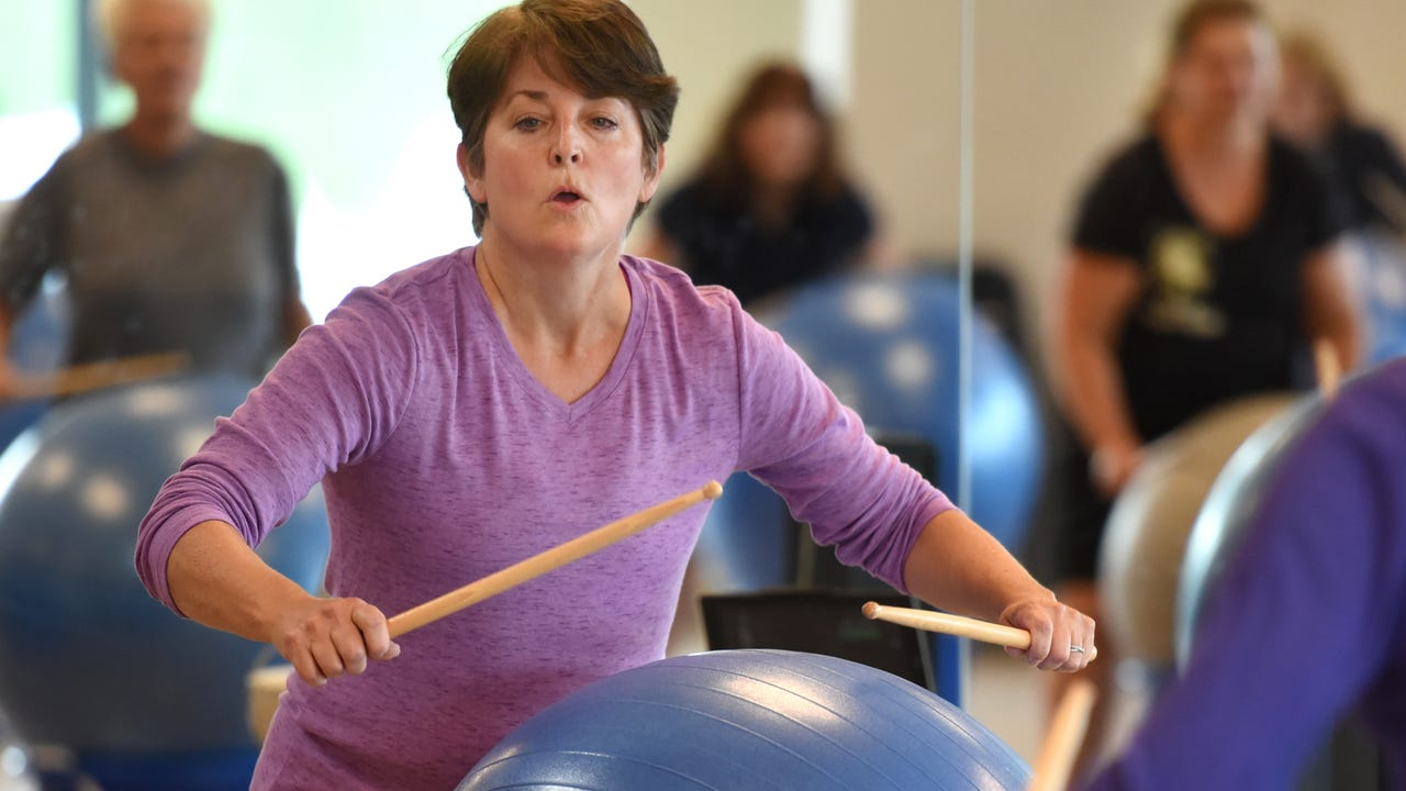 A few moments with a South Lyon Center for Active Adults cardio drumming class.