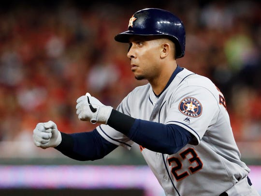 Houston Astros' Michael Brantley celebrates after a single against the Washington Nationals during the third inning of Game 4 of the baseball World Series Saturday, Oct. 26, 2019, in Washington. (AP Photo/Jeff Roberson)