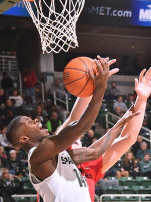 Spartan Eron Harris tries the backdoor with a reverse layup in the first half.
