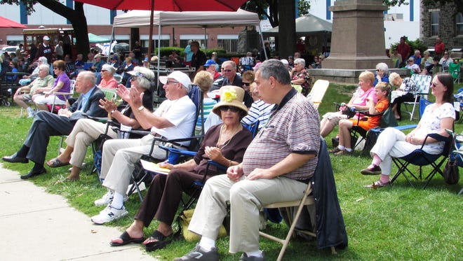 Visitors listen to dixieland jazz Saturday during the ninth annual Twin Tiers Michelob Jazz Festival at Wisner Park in Elmira.