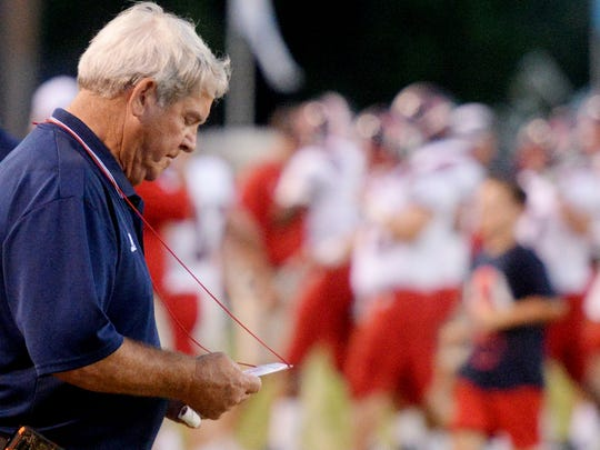 Former West Monroe head coach, the late Don Shows, studies a play card during his team's 2014 game against Airline.