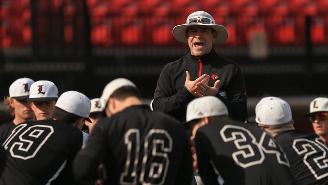 Louisville baseball head coach Dan McDonnell talks to his team before practice Tuesday afternoon. The Cardinals play Alabama State Friday at the 2017 Opening Weekend in Clearwater, Fla.