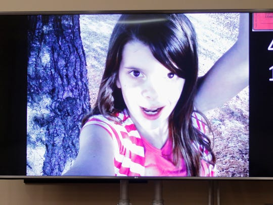 A photograph of Hailey Owens is shown in court during