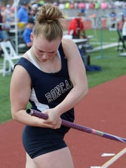 Manitowoc Roncalli's Kelly Jacoby prepares her grip before her pole vault attempt at last year's WIAA state track and field meet.