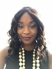 """Rachel Rochelle Wyche presented an illustrated book of the poem """"Ballad of Birmingham"""" at Nazareth College's Martin Luther King Jr. Day event, Jan. 15, 2018."""