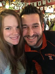 Adam Melchi and his wife, Sarah, smile together. Adam, 38, was found dead in a parking lot of the Indianapolis Motor Speedway the day after the Indianapolis 500.
