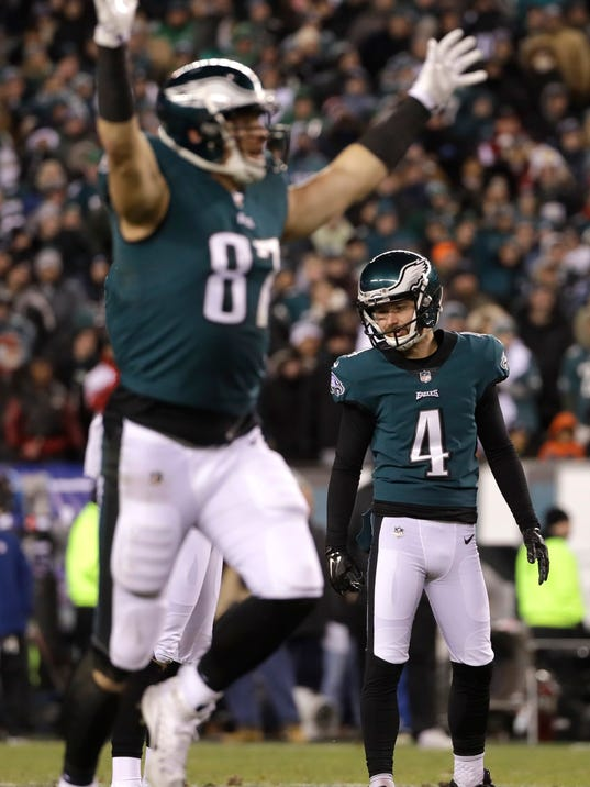 Philadelphia Eagles' Jake Elliott (4) and Brent Celek (87) react after Elliott kicked a field goal during the first half of an NFL divisional playoff football game against the Atlanta Falcons, Saturday, Jan. 13, 2018, in Philadelphia. (AP Photo/Michael Perez)
