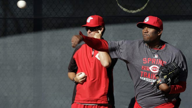 Cincinnati Reds right handed pitcher Jumbo Diaz pitches one of the first pitches as pitchers and catchers report for spring training 2015 in Goodyear Arizona.