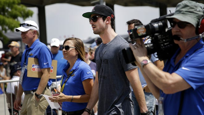 Indy 500 winner Alexander Rossi makes his way into the Pagoda prior to the Brickyard 400 at Indianapolis Motor Speedway on July 24, 2016.