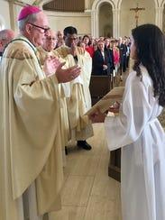 Most Rev. John Noonan, bishop of Orlando, left; Very